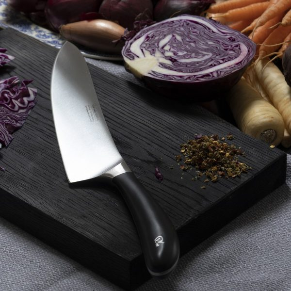 "25cm/10"" Cooks/Chef Knife on cutting board"