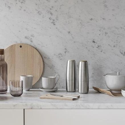 Salpi Matte Salt and Pepper Set on counter with other kitchen accessories