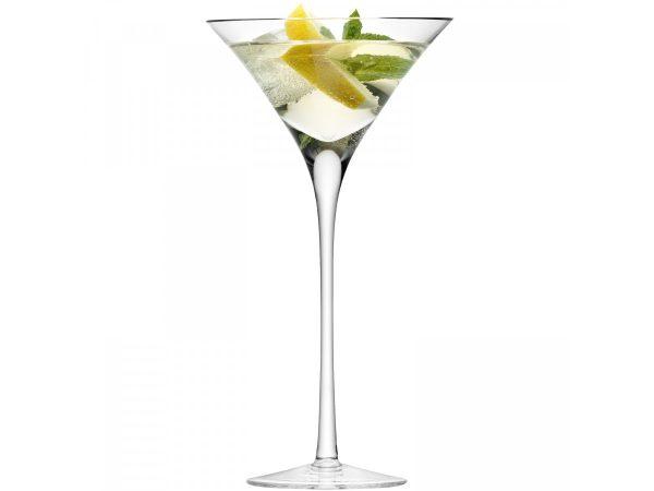 bar cocktail glass with lemon and lime twists